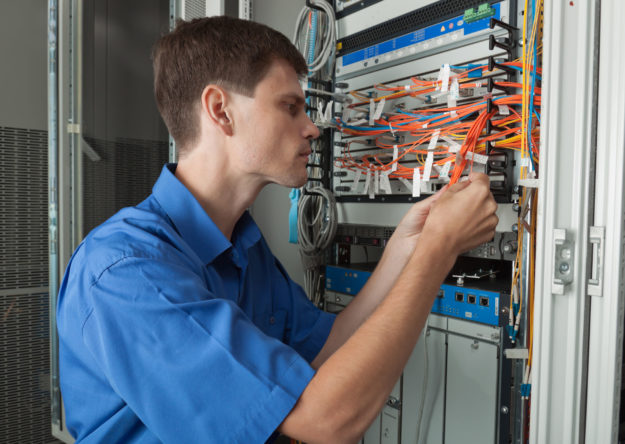 Senior network engineer in server room working