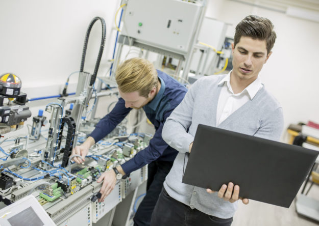 Engineer students in the factory