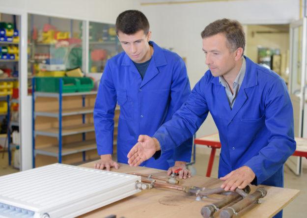 Men repairing a heater