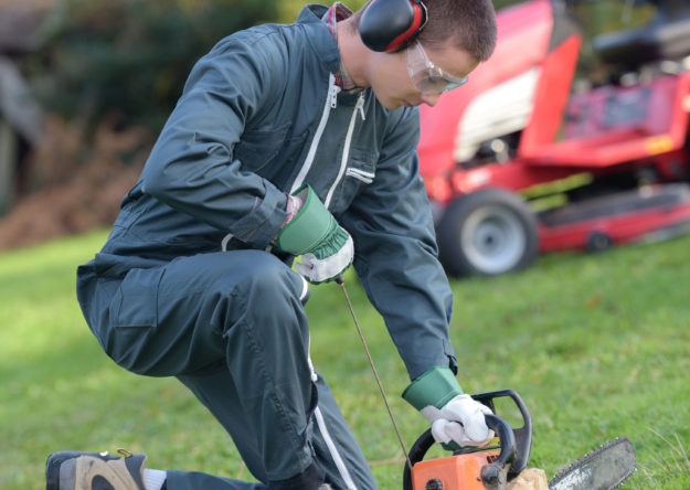 Student turning on a chainsaw