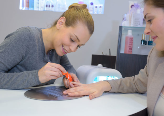 Woman getting her nails done at a beauty salon