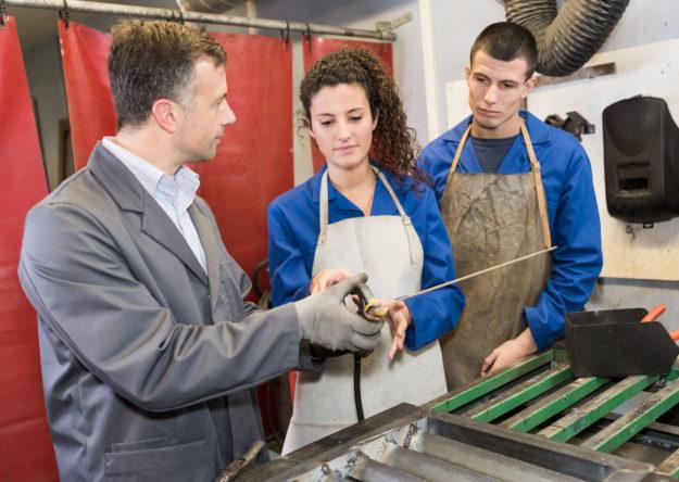 Metalwork students training in workshop